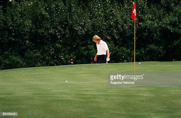 Ben Crenshaw pitches to the green during the 1974 Masters Tournament at Augusta National Golf Club in April 1974 in Augusta Georgia
