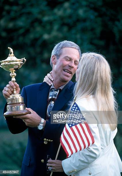 Ben Crenshaw the nonplaying captain of the United States team with his wife Julie and the trophy after the United States team wins the Ryder Cup golf...