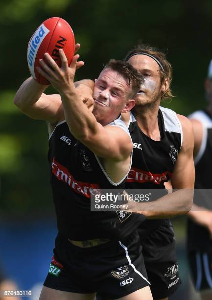 Ben Crocker of the Magpies marks infront of James Aish during a Collingwood Magpies AFL training session at Holden Centre on November 20 2017 in...
