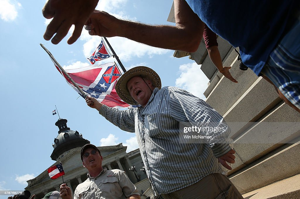 Ben Crosby, of Walterboro, South Carolina joins a group of demonstrators at the South Carolina State House while calling for the Confederate flag to remain on the State House grounds June 27, 2015 in Columbia, South Carolina. Earlier in the week South Carolina Gov. Nikki Haley expressed support for removing the Confederate flag from the State House grounds in the wake of the nine murders at Mother Emanuel A.M.E. Church in Charleston, South Carolina.