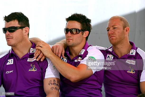 Ben Cross Cooper Cronk and Michael Crocker look on during the Melbourne Storm NRL Grand Final Victory Parade on October 2 2007 in Melbourne Australia