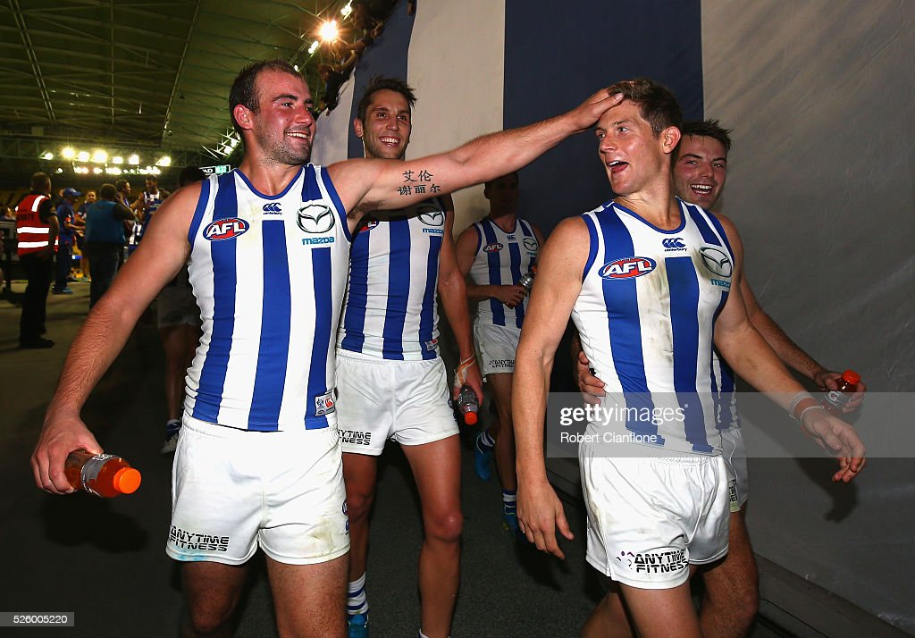 Ben Cunnington and Nick Dal Santo of the Kangaroos celebrate after the Kangaroos defeated the Bulldogs during the round six AFL match between the North Melbourne Kangaroos and the Western Bulldogs at Etihad Stadium on April 29, 2016 in Melbourne, Australia.