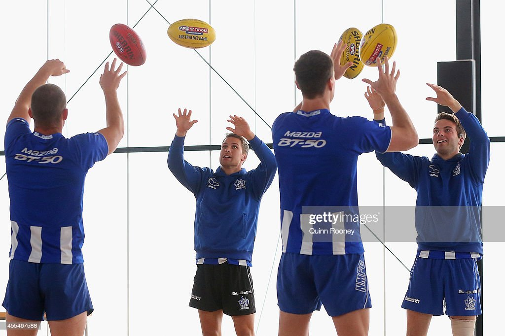 Ben Cunnington, Andrew Swallow, Daniel Currie and Luke McDonald of the Kangaroos pass balls during a North Melbourne Kangaroos AFL training session at Arden Street Ground on September 15, 2014 in Melbourne, Australia.