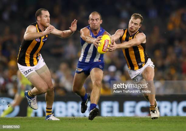 Ben Cunnington of the Kangaroos and Tom Mitchell of the Hawks compete for the ball during the 2018 AFL round five match between the North Melbourne...