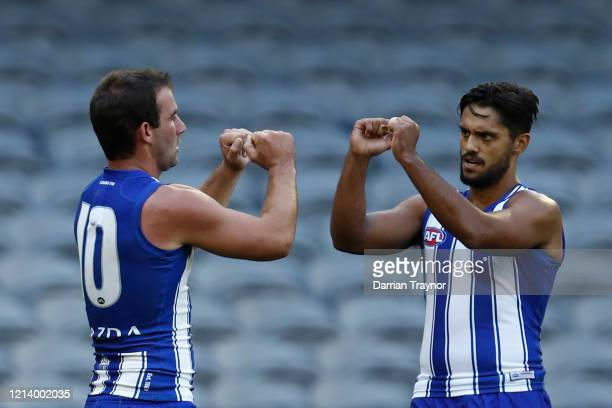 Ben Cunnington of the Kangaroos celebrates a goal during the round 1 AFL match between the North Melbourne Kangaroos and the St Kilda Saints at...
