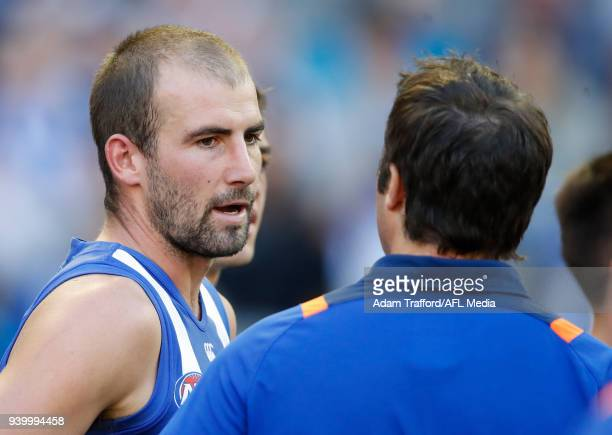 Ben Cunnington of the Kangaroos chats with Brad Scott Senior Coach of the Kangaroos during the 2018 AFL round 02 Good Friday Kick for the Kids match...