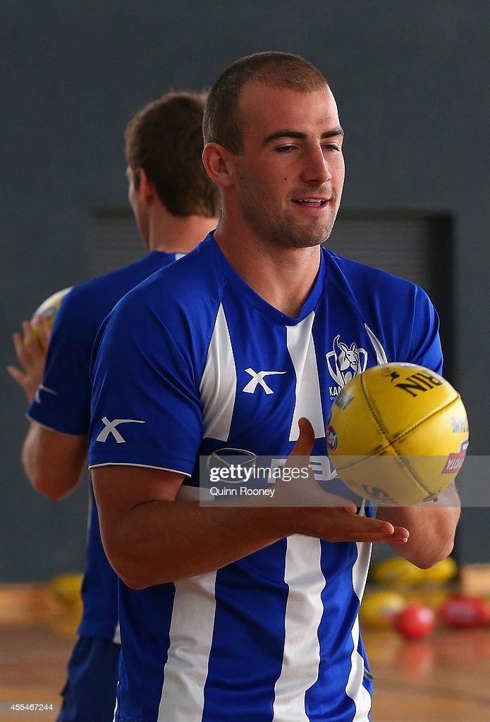 Ben Cunnington of the Kangaroos handballs during a North Melbourne Kangaroos AFL training session at Arden Street Ground on September 15, 2014 in Melbourne, Australia.