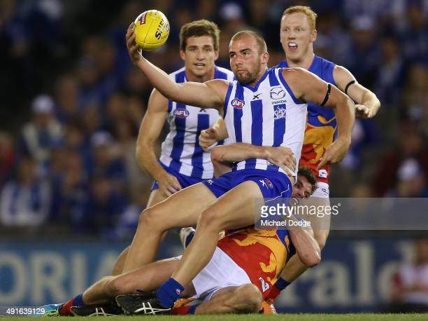 Ben Cunnington of the Kangaroos is tackled by Pearce Hanley of the Lions during the round nine AFL match between the North Melbourne Kangaroos and...