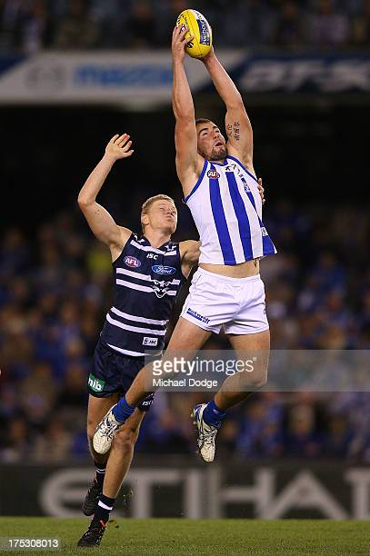 Ben Cunnington of the Kangaroos marks the ball against Taylor Hunt of the Cats during the round 19 AFL match between the North Melbourne Kangaroos...