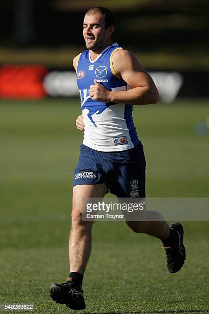 Ben Cunnington takes part in running drills during a North Melbourne Kangaroos AFL training session at Arden Street Ground on June 15 2016 in...