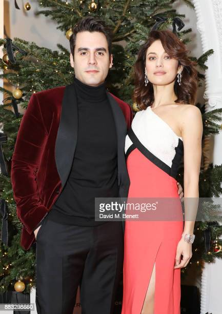 Ben Cura and Olga Kurylenko attend a party hosted by NETAPORTER and MR PORTER to celebrate the festive season in style at One Horse Guards on...