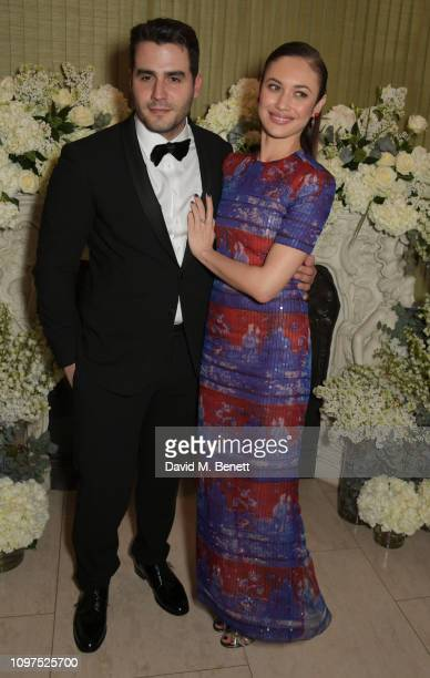 Ben Cura and Olga Kurylenko attend the British Vogue and Tiffany Co Celebrate Fashion and Film Party at Annabel's on February 10 2019 in London...