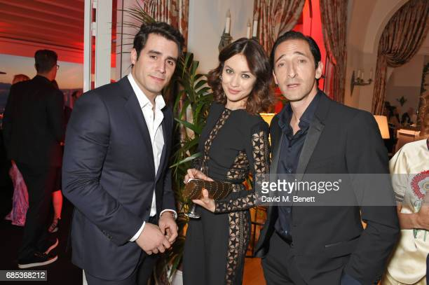 Ben Cura Olga Kurylenko and Adrien Brody attend The 9th Annual Filmmakers Dinner hosted by Charles Finch and JaegerLeCoultre at Hotel du CapEdenRoc...