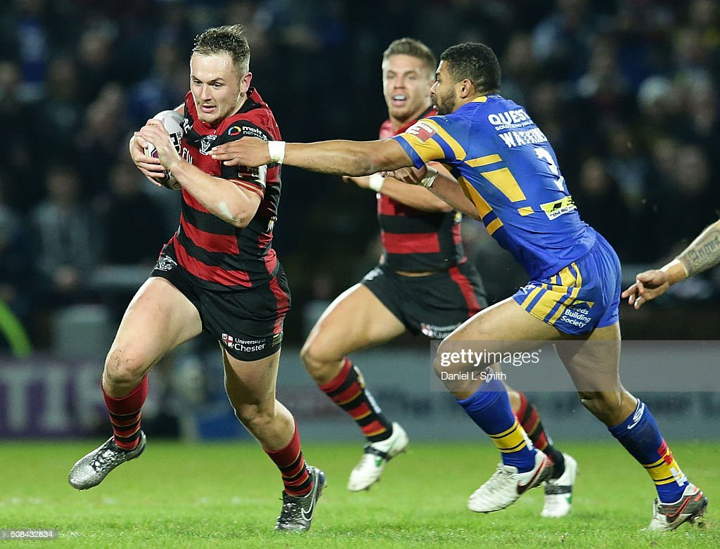 Ben Currie of Warrington Wolves breaks past Kallum Watkins of Leeds Rhinos during the First Utility Super League opening match between Leeds Rhinos and Warrington Wolves at Headingley Carnegie Stadium on February 4, 2016 in Leeds, England.