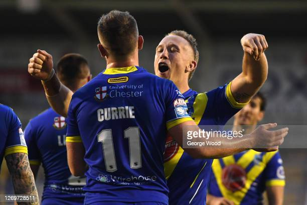 Ben Currie of Warrington Wolves celebrates with his team mates after scoring a try during the Betfred Super League match between Warrington Wolves...