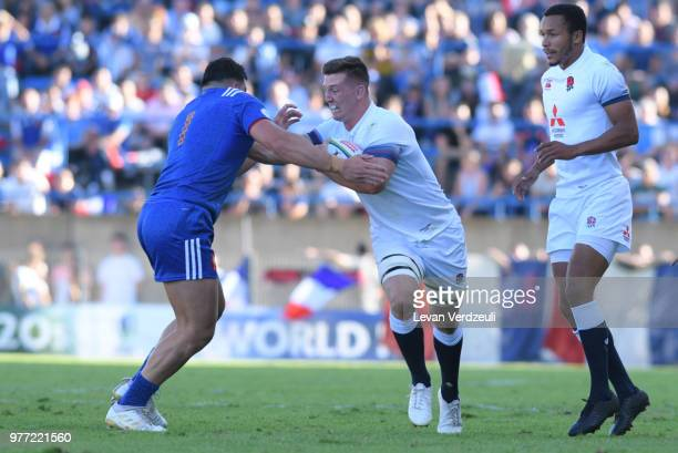 Ben Curry of England runs with ball and Jean Baptiste Gros of France tackles him during the World Rugby Under 20 Championship Final between England...