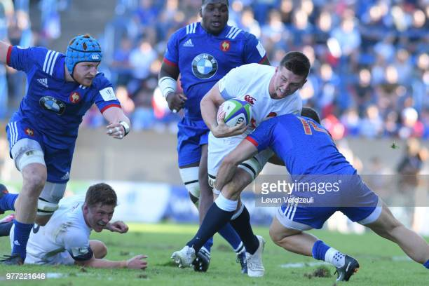 Ben Curry of Enland is tackled during the World Rugby Under 20 Championship Final between England and France on June 17 2018 in Beziers France