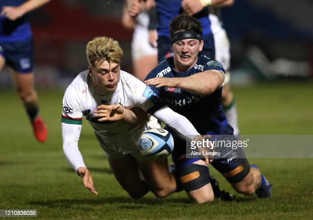 Ben Curry of Sale Sharks and Ollie Hassell Collins of London Irish chase the ball during the Gallagher Premiership Rugby match between Sale Sharks...