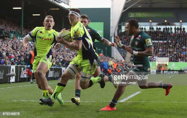 Ben Curry of Sale Sharks collects the kick through to score a try during the Aviva Premiership match between Leicester Tigers and Sale Sharks at...