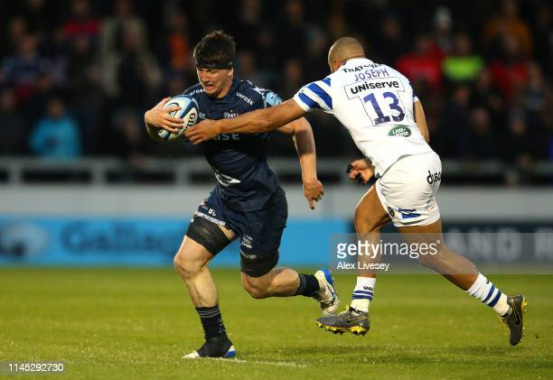 Ben Curry of Sale Sharks is tackled by Jonathan Joseph of Bath Rugby during the Gallagher Premiership Rugby match between Sale Sharks and Bath Rugby...