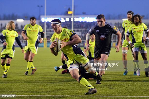 Ben Curry of Sale Sharks scores a try during the Aviva Premiership match between Newcastle Falcons and Sale Sharks at Kingston Park on April 13, 2018...