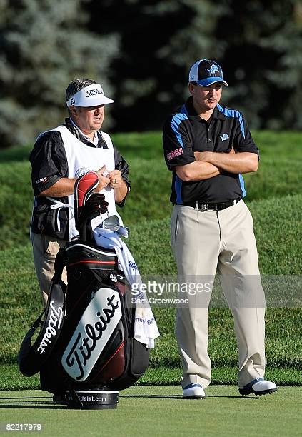 Ben Curtis stands alongside his caddie Andrew Sutton on the second fairway during round two of the 90th PGA Championship at Oakland Hills Country...
