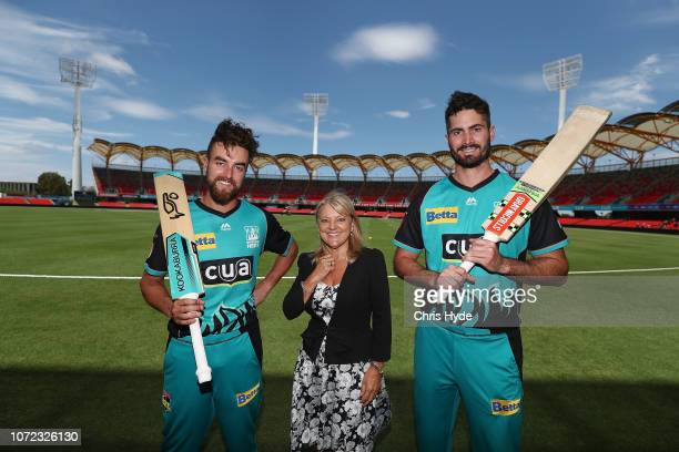 Ben Cutting and Alex Ross pose with Gold Coast Council Deputy Mayor Donna Gates during a Brisbane Heat BBL media opportunity at Metricon Stadium on...