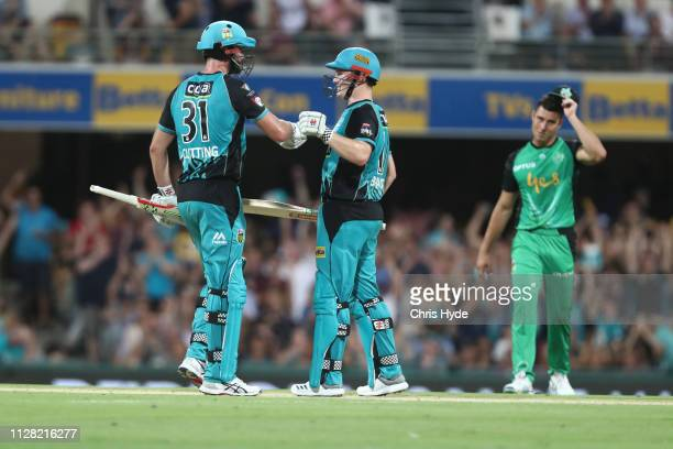 Ben Cutting and Max Bryant of the Heat celebrate winning the Brisbane Heat v Melbourne Stars Big Bash League Match at The Gabba on February 08, 2019...