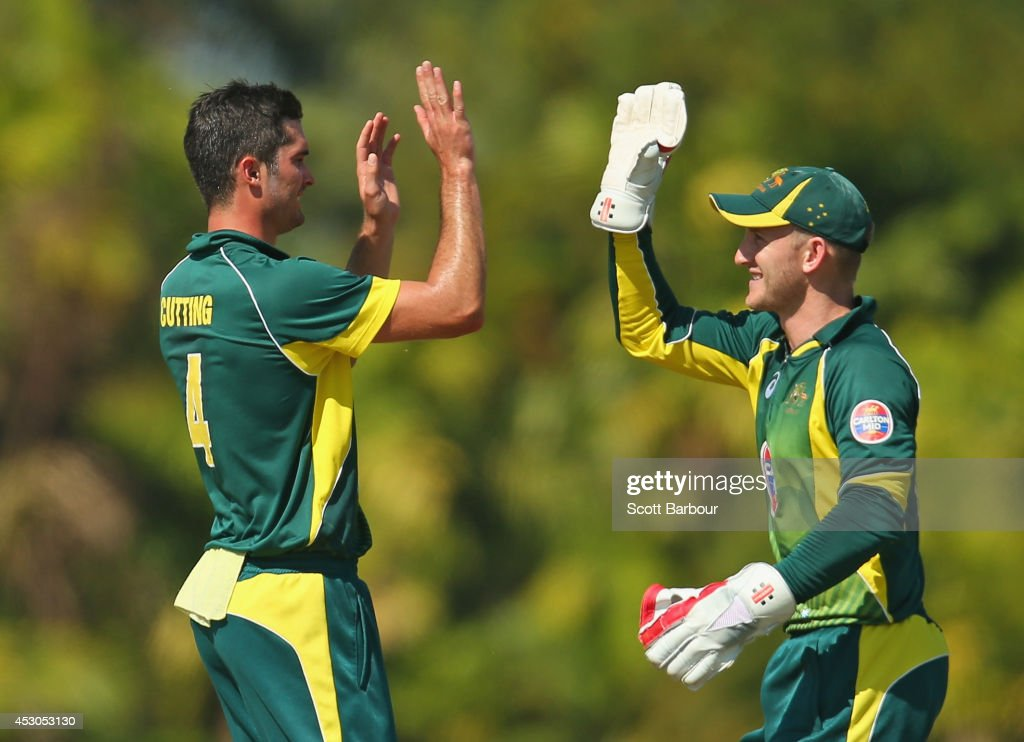 Ben Cutting of Australia 'A' is congratulated by Peter Nevill after dismissing Ambati Rayudu of India 'A' during the Cricket Australia Quadrangular Series Final match between Australia 'A' and India 'A' at Marrara Oval on August 2, 2014 in Darwin, Australia.