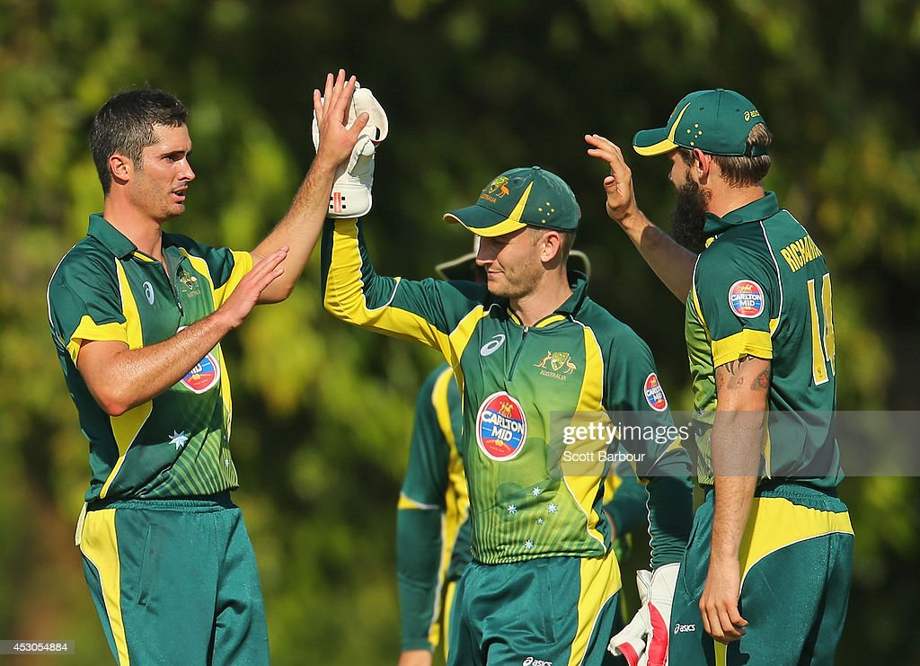 Ben Cutting of Australia 'A' is congratulated by Peter Nevill and Kane Richardson after dismissing Manoj Tiwary of India 'A' during the Cricket Australia Quadrangular Series Final match between Australia 'A' and India 'A' at Marrara Oval on August 2, 2014 in Darwin, Australia.