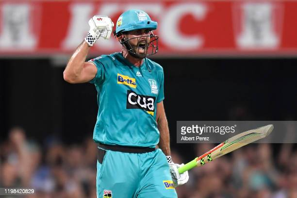 Ben Cutting of the Heat celebrates his team's win during the Big Bash League match between the Brisbane Heat and the Hobart Hurricanes at the Gabba...