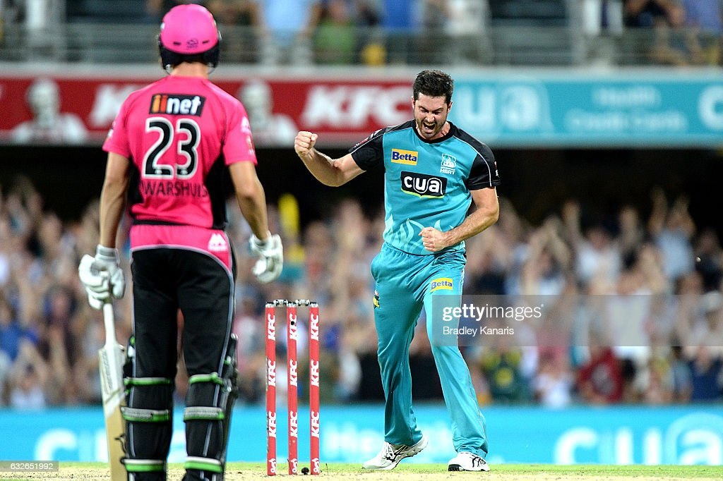 Ben Cutting of the Heat celebrates taking the wicket of Johan Botha of the Sixers during the Big Bash League semi final match between the Brisbane Heat and the Sydney Sixers at the The Gabba on January 25, 2017 in Brisbane, Australia.