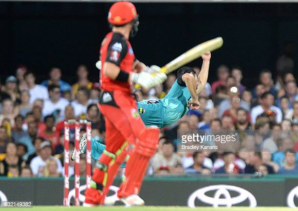 Ben Cutting of the Heat dives as he attempts to take a catch during the Big Bash League match between the Brisbane Heat and the Melbourne Renegades...