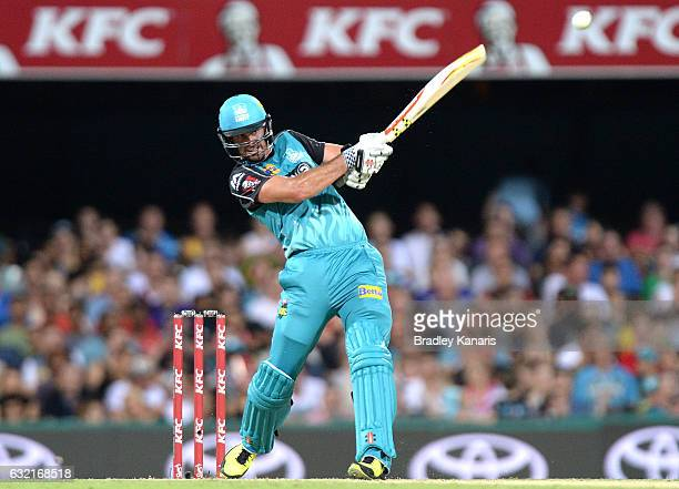 Ben Cutting of the Heat hits the ball over the boundary for a six during the Big Bash League match between the Brisbane Heat and the Melbourne...