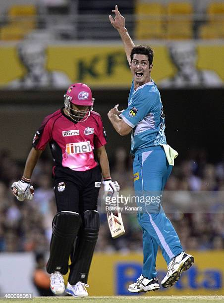 Ben Cutting of the Heat takes the wicket of Ravinder Bopara of the Sixers during the Big Bash League match between Brisbane Heat and the Sydney...
