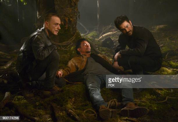 Ben Daniels John Cho and Alfonso Herrera in the season finale 'Unworthy' episode of THE EXORCIST airing Friday Dec 15 on FOX
