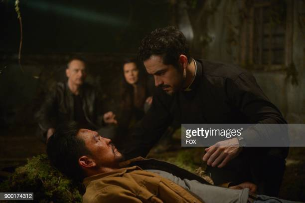 Ben Daniels John Cho Zuleikha Robinson and Alfonso Herrera in the season finale 'Unworthy' episode of THE EXORCIST airing Friday Dec 15 on FOX