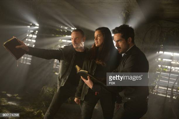 Ben Daniels Zuleikha Robinson and Alfonso Herrera in the season finale 'Unworthy' episode of THE EXORCIST airing Friday Dec 15 on FOX