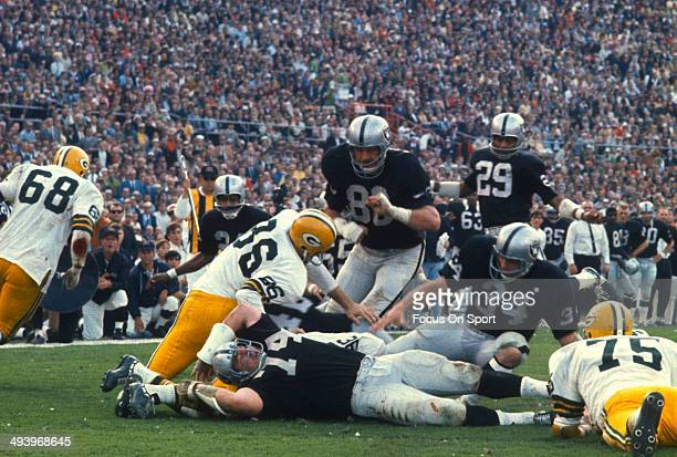 January 14: Ben Davidson, Gus Otto and Tom Keating of the Oakland Raiders in action against the Green Bay Packers during Super Bowl II January 14,...