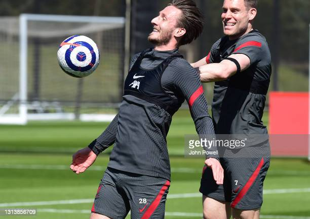 Ben Davies and James Milner of Liverpool during a training session at AXA Training Centre on April 22, 2021 in Kirkby, England.