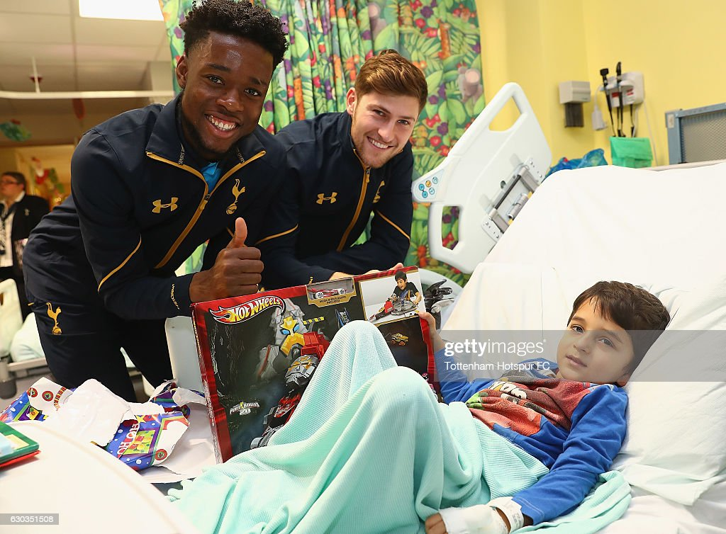 Ben Davies and Josh Onomah of Tottenham Hotspur deliver Christmas presents to Children at Barnet Hospital on December 21, 2016 in London, England.