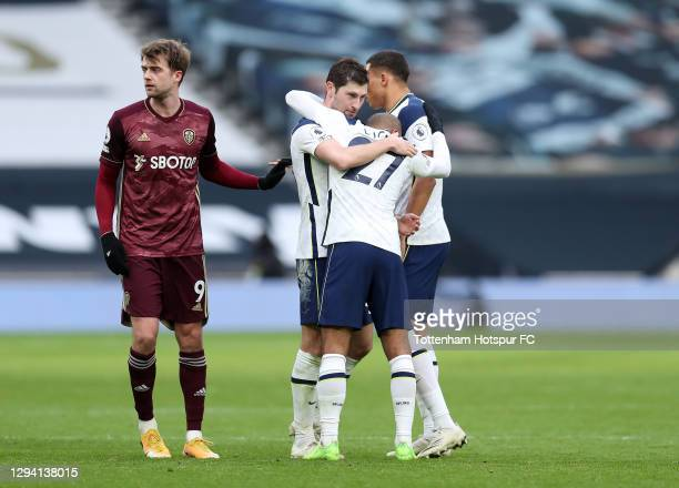 Ben Davies and Lucas of Tottenham Hotspur celebrate following their sides victory in the Premier League match between Tottenham Hotspur and Leeds...