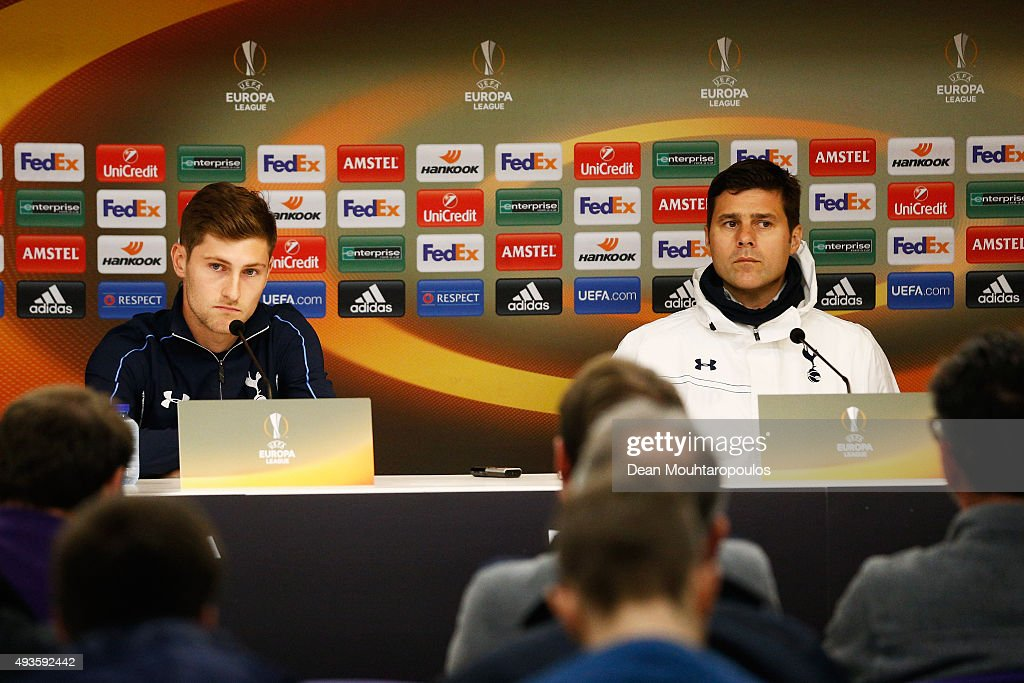 Ben Davies (L) and Mauricio Pochettino, head coach / manager of Tottenham Hotspur speak to the media during the Tottenham Hotspur press conference ahead of the UEFA Europa League match against Anderlecht at Constant Vanden Stock Stadium on October 21, 2015 in Brussels, Belgium.