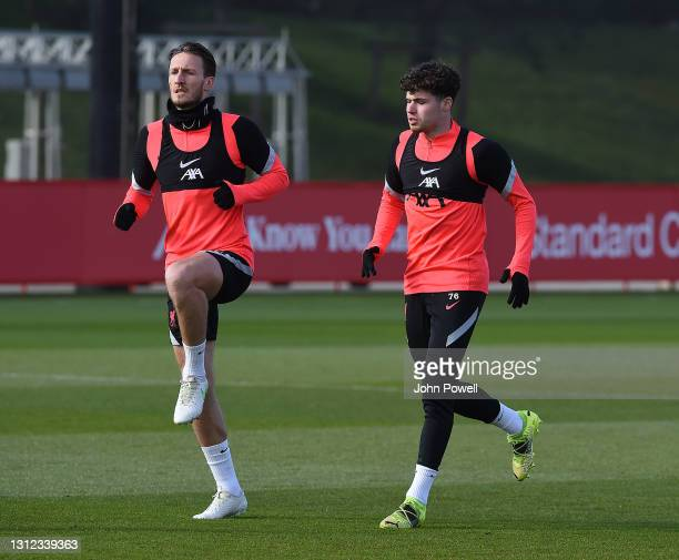 Ben Davies and Neco Williams of Liverpool during a training session at AXA Training Centre on April 13, 2021 in Kirkby, England.