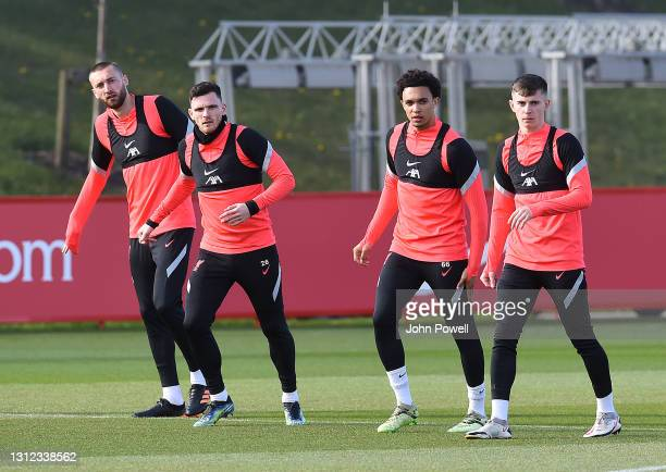 Ben Davies, Andy Robertson, Trent Alexander-Arnold and Ben Woodburn of Liverpool during a training session at AXA Training Centre on April 13, 2021...