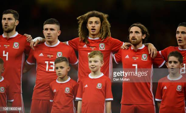 Ben Davies Declan John Ethan Ampadu Joe Allen and Harry Wilson of Wales line up for the national anthem prior to the International Friendly match...