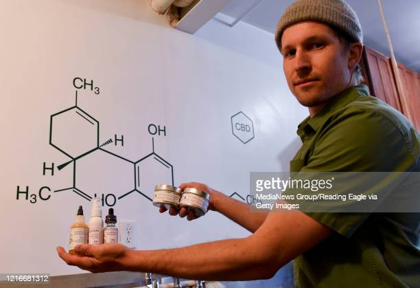 Ben Davies displays CBD Oil products produced at his Wild Fox Farm in Barto Pa Monday March 30 as the coronavirus epidemic forces changes in the way...