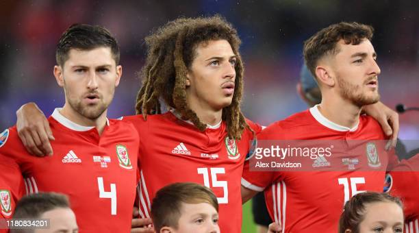 Ben Davies, Ethan Ampadu and Tom Lockyer of Wales sing the national anthems during the UEFA Euro 2020 qualifier between Wales and Croatia at Cardiff...
