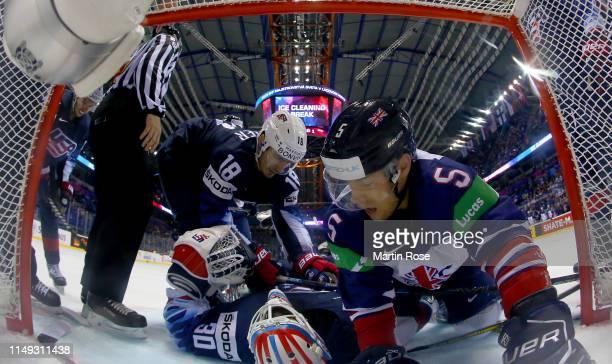 Ben Davies of Great Britain crashes into Thatcher Demko, goaltender of United States during the 2019 IIHF Ice Hockey World Championship Slovakia...