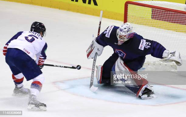 Ben Davies of Great Britain scores the winning goal in overtime over Florian Hardy of France during the 2019 IIHF Ice Hockey World Championship...